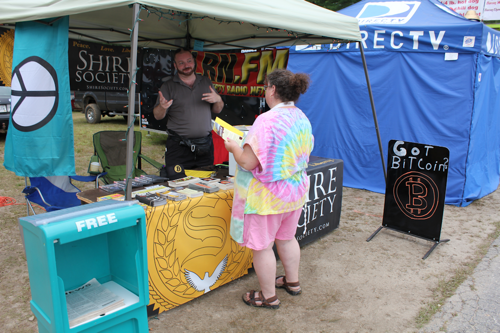 Christopher Cantwell explains Bitcoin to a new Shire Society signer at the 2014 Cheshire Fair