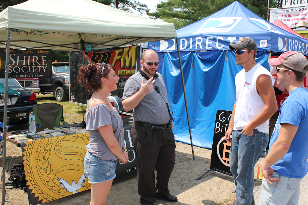 Josie Wales and Chris Cantwell talk about Bitcoin to attendees at the 2014 Cheshire Fair